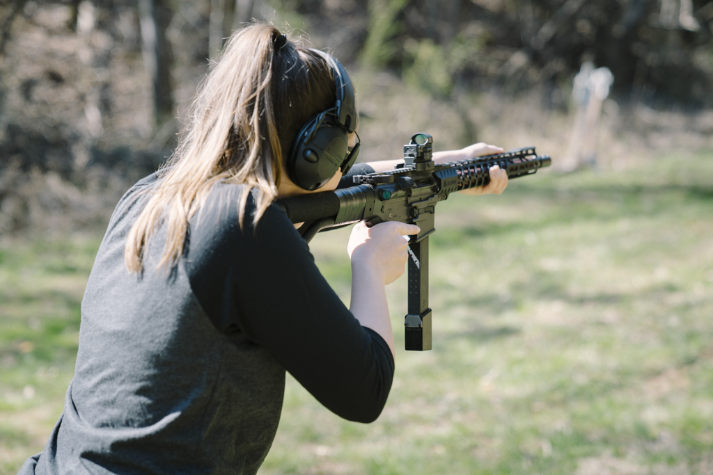 the author shooting a 9mm pistol caliber carbine at the range