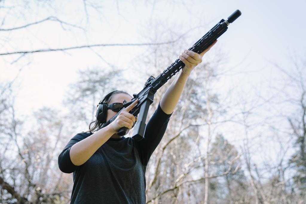 the author shooting a pistol caliber carbine