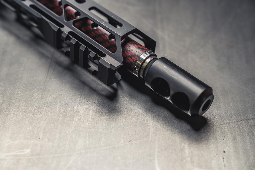 a pistol caliber carbine with an upgraded carbon fiber barrel and compensator