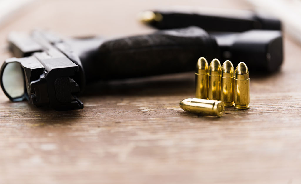 Full Metal Jacket 9mm ammo and a pistol with a red dot reflex sight