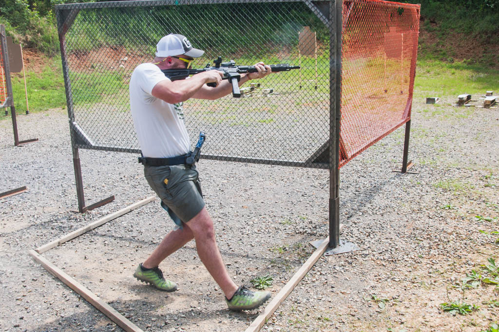 a PCC shooter shooting a USPSA stage
