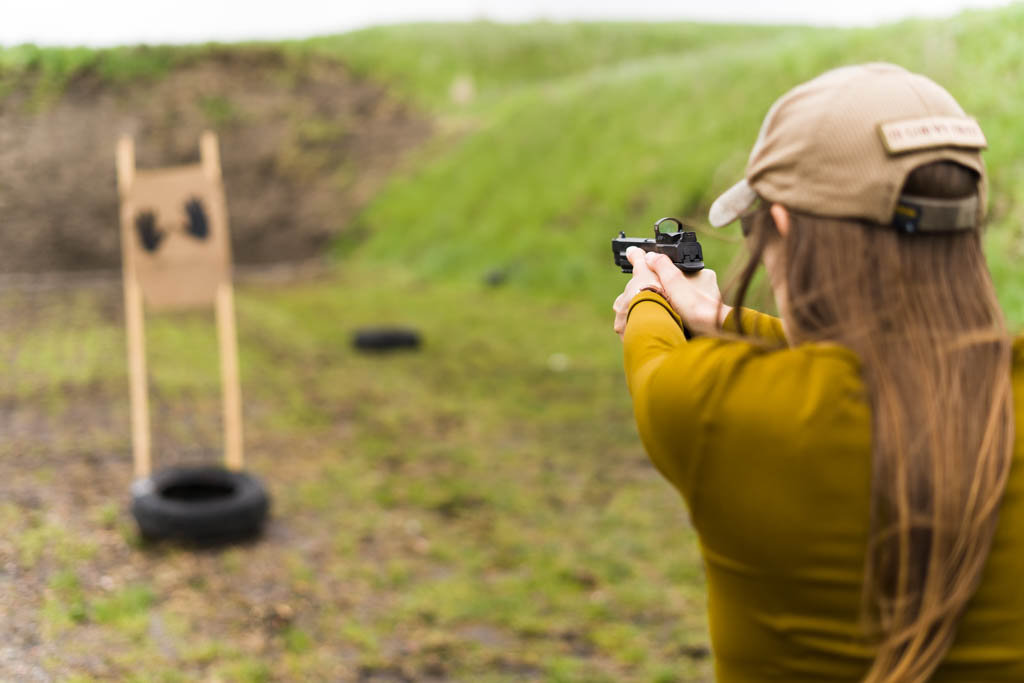 the author Emily shooting a pistol at a target with FMJ ammo