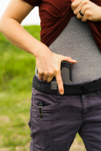 the author drawing her concealed carry gun loaded with JHP ammo