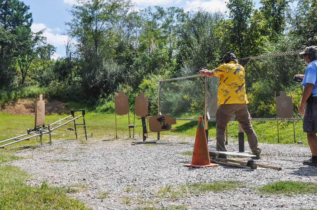 IDPA scoring in action as a shooter neutralizes a moving target