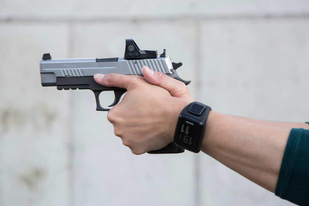 Demonstrating the proper pistol grip to help manage recoil