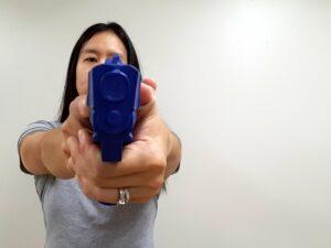 Pistol held shifted across centerline