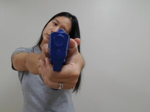 Pistol held with head tilted to one side